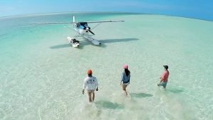 video screen capture of a Sea Plane on salt flat in the backcountry of the florida keys.